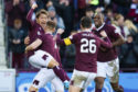 Ryotaro Meshino celebrates with his teammates after making it 1-0 to Hearts during the Ladbrokes Premiership match between Hearts and Aberdeen, at Tynecastle Park, on December 29.