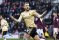 Niall McGinn rescued a point for the Dons.