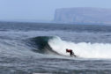 Surfing five miles from Caithness. Pic: VisitScotland.