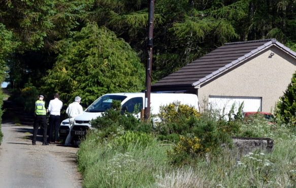 Police in Cuminestown following the death