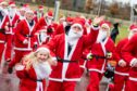 Runners dressed as Santa take part in a Santa Fun Run at the Inverness Campus.