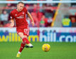 Dylan McGeouch in action during the William Hill Scottish Cup fourth round tie between Aberdeen and Dumbarton.