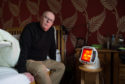 Chris Bridgeford, chairman of Affa Sair chronic pain campaign group, at his Forres home. Picture by Jason Hedges.