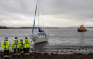 Oban lifeboat and coastguard members aid a stricken yacht in Connel Bay