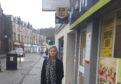 Councillor Julie McKenzie outside the McColls shop in George Street which sells electricity