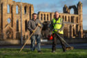 James Wiseman (left) and Douglas Read who are both members of the community grass cutting group. Picture by Jason Hedges.