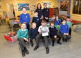 Some of the children from the Inverurie Out of School Club with the P&J minibus poster.   Picture by Scott Baxter