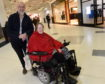 Norman MacLeod, general manager, and Gale Falconer, founder of Shopmobility Highland photographed in the Eastgate Shopping Centre. Picture by Sandy McCook