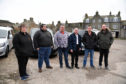 BROCH TAXI DRIVERS WHO ARE CONCERNED WITH THE RAMIFICATIONS OF UNLICENSED TAXIS OPERATING IN THE TOWN. (L TO R) ELAINE MORRISON, THOMAS BEEDIE, RODNEY WATSON,BILLY DOWNIE, SHAUN DOWNIE AND JOHN RITCHIE.