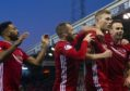 Aberdeen's Sam Cosgrove celebrates with teammates during the William Hill Scottish Cup 4th round tie between Aberdeen and Dumbarton