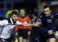 Ayr's Aaron Muirhead (L) and Ross County's Sean Kelly in action